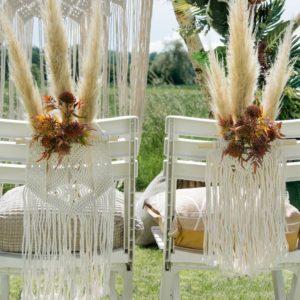 Makramee-Stuhldekoration für das Brautpaar